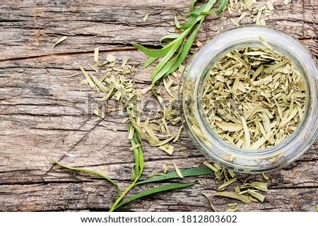 Tarragon or estragon.Fresh and dry tarragon herb #1812803602