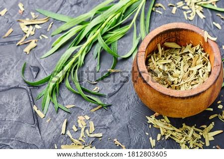 Tarragon or estragon.Fresh and dry tarragon herb #1812803605