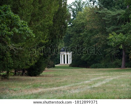 The ancient Temple is placed in the beautiful Georgen Park in Dessau. Temple is build with white pillars and a black dome. #1812899371