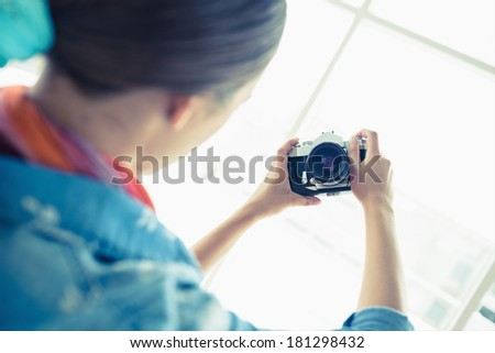 Young woman taking a selfie at home in the living room #181298432