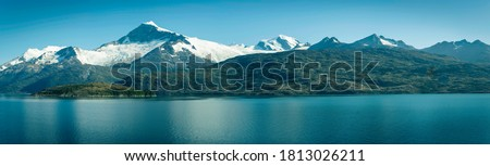 Beautiful view of the Chilean Fjords region in south Patagonia in Chile. Cruise ship sailing the Glacier Alley from the Beagle channel to the Pacific Ocean. Incredible view of the high mountains Royalty-Free Stock Photo #1813026211
