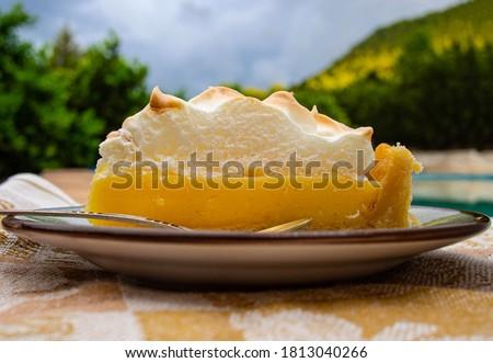 Lemon meringue pie on a rustic saucer