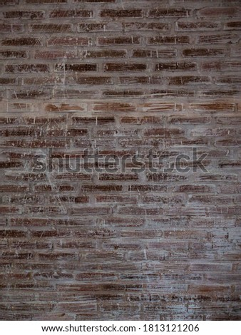 brown brick wall with grunge background and vignetted.