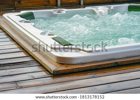 View of the open working hot tub. Pool cleaner during his work. Royalty-Free Stock Photo #1813178152