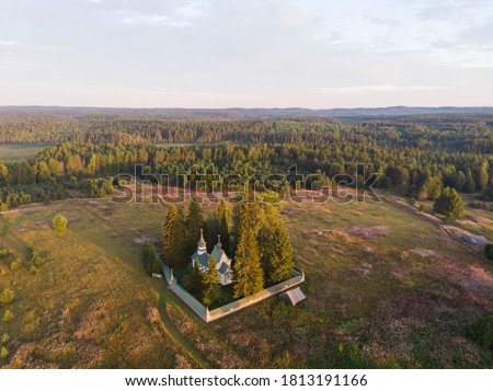Porzhensky churchyard. A beautiful wooden temple among the fields. View from above #1813191166