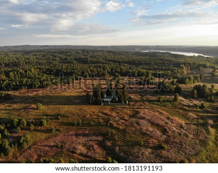 Porzhensky churchyard. A beautiful wooden temple among the fields. View from above #1813191193