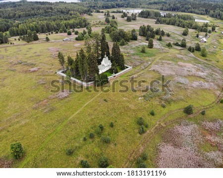 Porzhensky churchyard. A beautiful wooden temple among the fields. View from above #1813191196