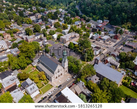 Scenic seasonal landscape from above aerial view of a small town countryside of Lambertville New Jersey USA in the historic city New Hope Pennsylvania US. Royalty-Free Stock Photo #1813265128
