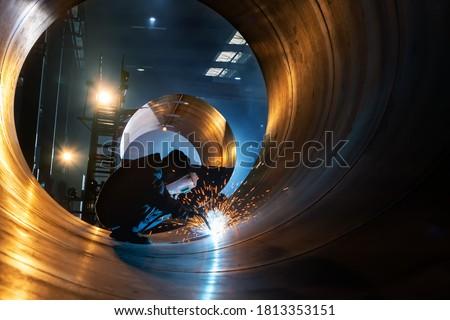The welder is welding steel plates Royalty-Free Stock Photo #1813353151