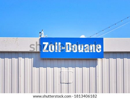 Sign with the German word Zoll means customs duty and the French word Douane means customs.
