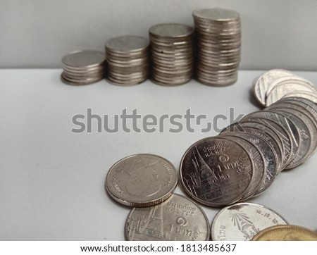 Picture of coins used to compose economic conditions