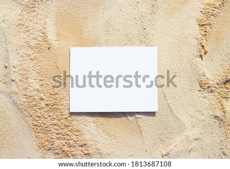 White canvas on the natural background with sand. Sunny day in the park.  Free space for your design