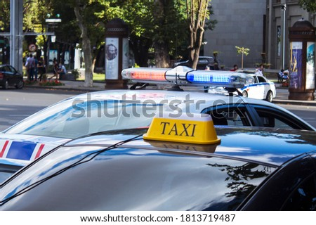 taxi sign by car and traffic police
