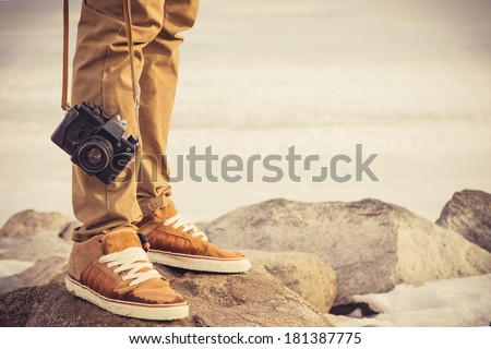 Feet man and vintage retro photo camera outdoor Travel Lifestyle vacations concept