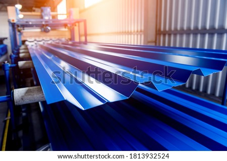 Metal sheet forming machine at the modern metalwork factory. Royalty-Free Stock Photo #1813932524