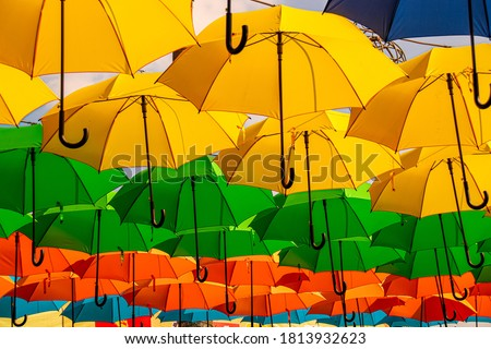 Brightly colored hanging umbrella as a tropical summer theme decoration
