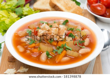 vegetable minestrone with croutons on a plate, close-up, horizontal #181398878