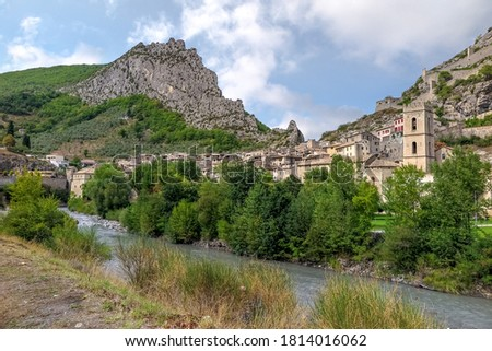 Small French medieval town between two rocky hills and the Var river, Commune of Entrevaux, Provence-Alpes-Côte d'Azur region, Alpes de Haute Provence, France Royalty-Free Stock Photo #1814016062