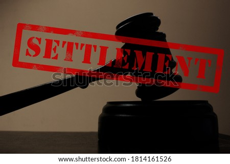 judges court gavel silhouette with Settlement stamp Royalty-Free Stock Photo #1814161526
