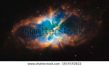 NGC 2818 is a planetary nebula located in the southern constellation Pyxis. Royalty-Free Stock Photo #1814192822