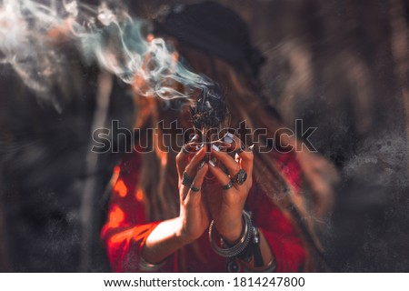 close up of woman hands with shamanic fire outdoors Royalty-Free Stock Photo #1814247800