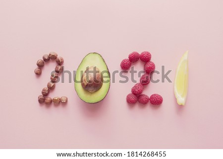 2021 made from healthy food on pink background, Happy New year, health diet resolution, goals and lifestyle #1814268455