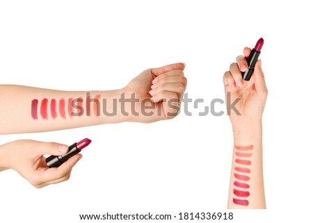 Lipstick swatches on woman hand isolated on white background. #1814336918