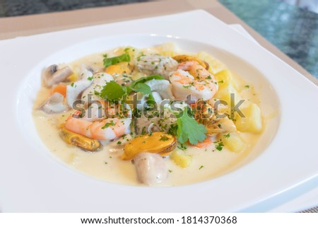 close up of Waterzooi belgium dish woth seafoods, shrimps, mussels, cream and potatoes.