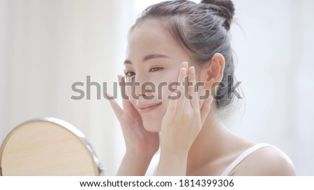 Young woman doing skin care Royalty-Free Stock Photo #1814399306