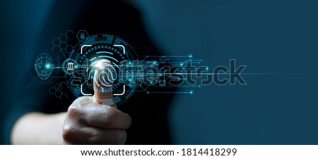 Businessman using fingerprint indentification to access personal financial data. Idea for E-kyc (electronic know your customer), biometrics security, innovation technology against digital cyber crime Royalty-Free Stock Photo #1814418299