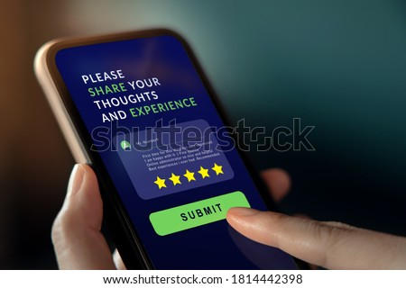 Customer Experiences Concept. Woman Using Mobile Phone to Giving Feedback via the Internet. Positive Review. Client Satisfaction Surveys #1814442398