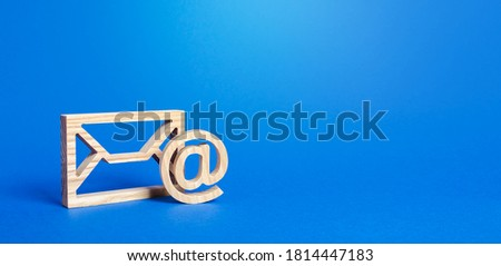 Email figure on blue background. Envelope and AT commercial sign symbol. Concept of email address. Contacts and communication. Business representations on the Internet and social media. Feedback Royalty-Free Stock Photo #1814447183