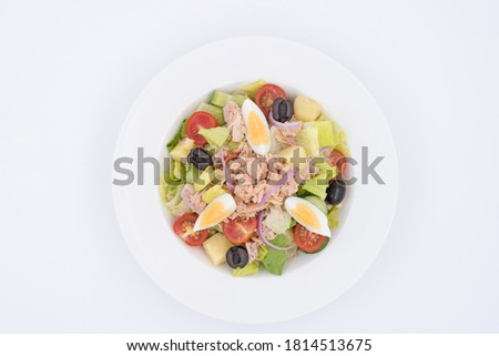 Tuna salad in transparent bowl with eggs in a white plate #1814513675