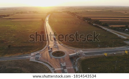 Roundabout circular intersection road traffic aerial drone view