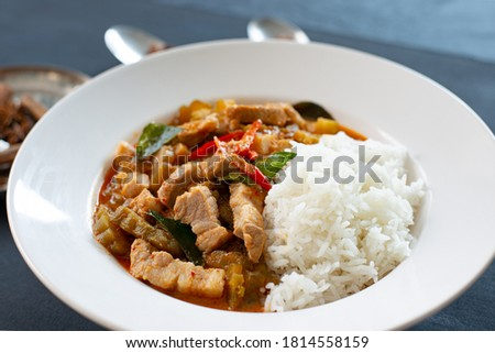 picture from above close up Red curry with rice, thailand street food