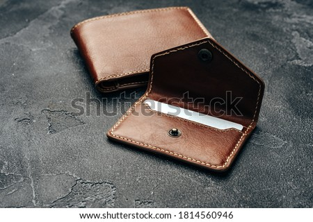 New brown leather wallet on dark background Royalty-Free Stock Photo #1814560946