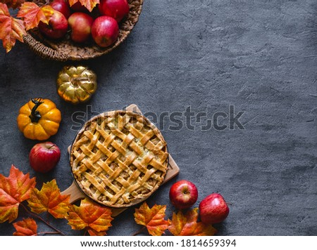 Autumn apple pie. Traditional american apple pie with fresh apples and cinnamon. Top view, copy space. Classic autumn Thanksgiving pastry dessert Royalty-Free Stock Photo #1814659394