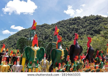 Amazing believe of Thai people for good luck.Its such a famous temple you will find roosters through out the way to the temple
