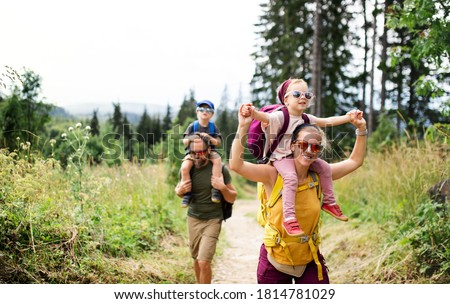 Family with small children hiking outdoors in summer nature. Royalty-Free Stock Photo #1814781029