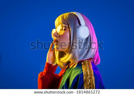 Fashion portrait of beautiful woman on colored background Royalty-Free Stock Photo #1814865272
