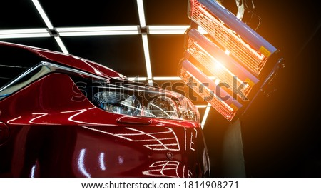Infrared lamps for drying of car body parts after applying save gloss coating Royalty-Free Stock Photo #1814908271