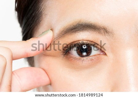 A woman is picking the corner of her eye. Royalty-Free Stock Photo #1814989124