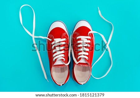 red sports shoes sneakers with white laces Royalty-Free Stock Photo #1815121379