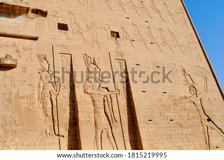 The entrance relief of Temple of Horus, Sky God, depicted as a falcon-headed man. Edfu, West bank of the Nile, Aswan Egypt.