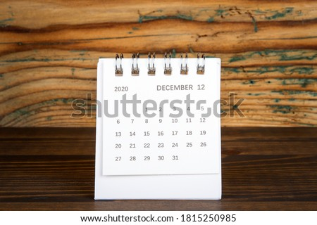 2020 DECEMBER. White paper calendar on a wooden table. Time planning, day counting and holidays Royalty-Free Stock Photo #1815250985