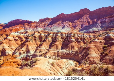 Paria Canyon-Vermilion Cliffs Wilderness Area. Huge slopes of red sandstone, striped from various inclusions of light rocks. Arizona and Utah, USA. The concept of active, extreme and photo tourism #1815254141