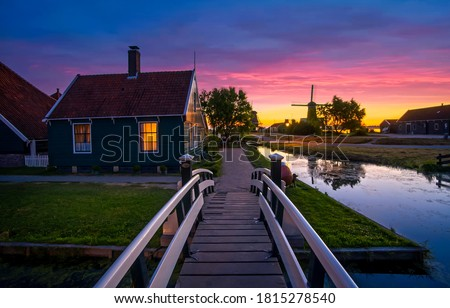 Sunset river village scene. River bridge in sunset village. Sunset village scene. Village sunset sky landscape #1815278540