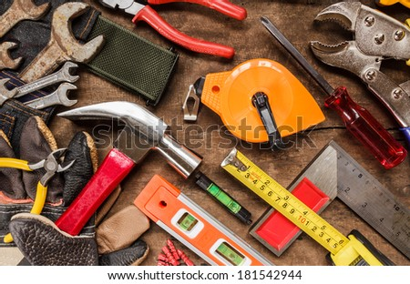 tool renovation on brown wood background #181542944