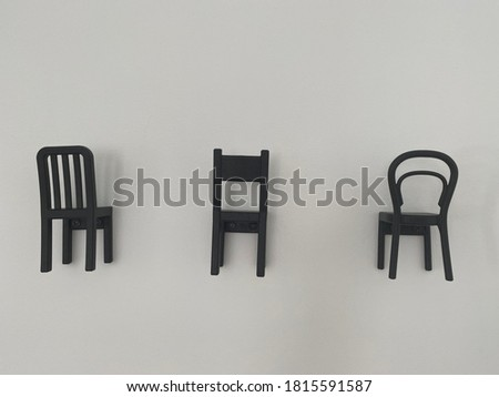 Chairs decorating the white wall #1815591587