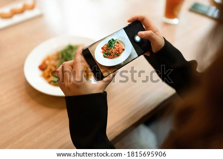 Taking a picture of pasta with smartphone.